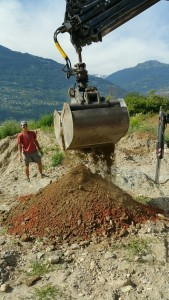 Mixing the substrates: excavation soil, crushed bricks and gravels on site